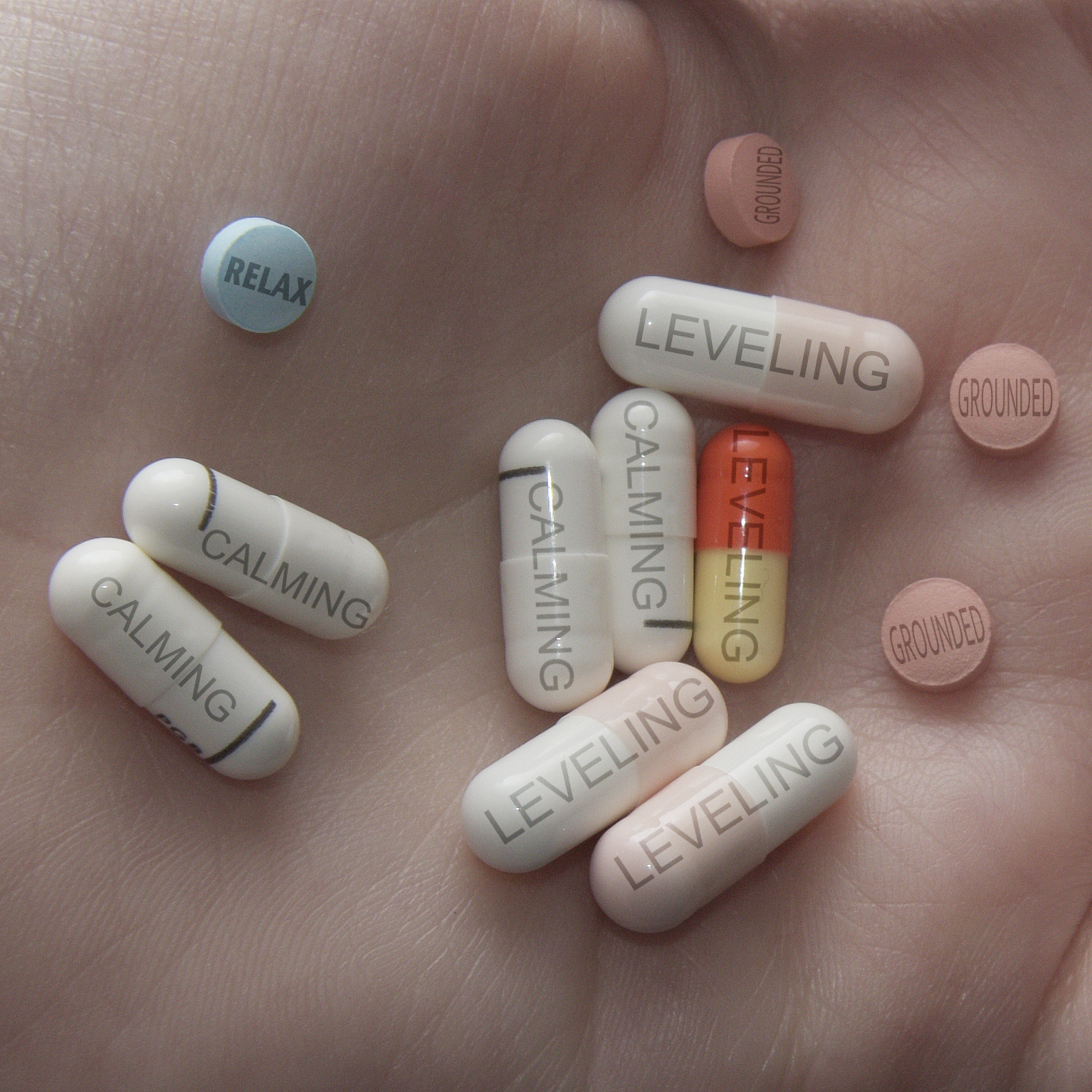 Image of pills, with words like Calming and Levelling on them